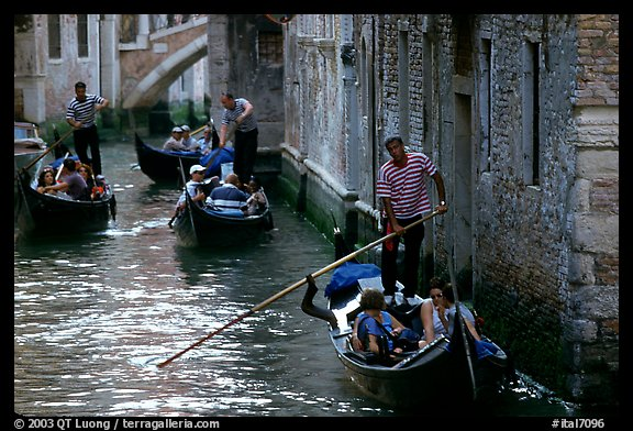 Several gondolas in a narrow canal. Venice, Veneto, Italy (color)