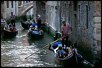 Several gondolas in a narrow canal. Venice, Veneto, Italy
