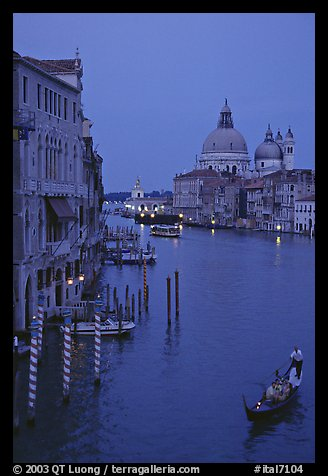 Gondola, Grand Canal, Santa Maria della Salute church from the Academy Bridge, dusk. Venice, Veneto, Italy (color)