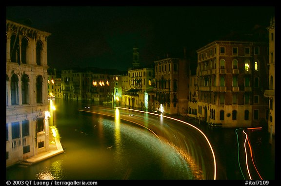 Light trails on the Grand Canal at night near the Rialto Bridge. Venice, Veneto, Italy (color)