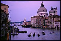 Gondolas, Grand Canal, Santa Maria della Salute church from the Academy Bridge, dusk. Venice, Veneto, Italy