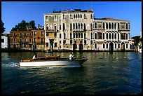 Water taxi passes in front of the Palazzo Dorio on the Grand Canal. Venice, Veneto, Italy (color)