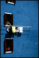 Windows, hanging laundry, blue house, Burano. Venice, Veneto, Italy ( color)