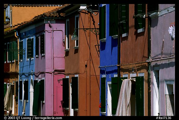 Facades of brightly painted houses, Burano. Venice, Veneto, Italy (color)