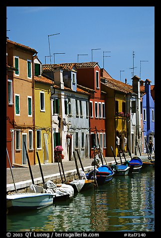 Canal lined with brightly painted houses, Burano. Venice, Veneto, Italy (color)