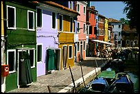 Canal bordered by multicolored  houses, Burano. Venice, Veneto, Italy ( color)