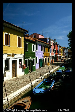 Canal lined with houses painted with bright colors, Burano. Venice, Veneto, Italy (color)