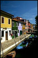 Canal lined with houses painted with bright colors, Burano. Venice, Veneto, Italy ( color)