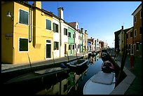 Colorful painted houses along canal, Burano. Venice, Veneto, Italy