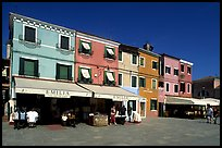 Street with brightly painted houses, Burano. Venice, Veneto, Italy