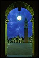 Campanile and Piazza San Marco (Square Saint Mark) seen from arcades at night. Venice, Veneto, Italy