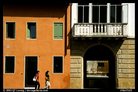 House facades with women walking. Veneto, Italy (color)