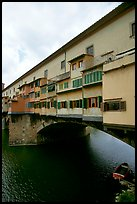 Ponte Vecchio bridge covered with shops, spanning  Arno River. Florence, Tuscany, Italy (color)