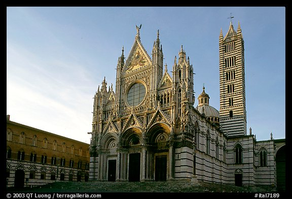 Siena Cathedral (Duomo) with bands of colored marble, late afternoon. Siena, Tuscany, Italy (color)