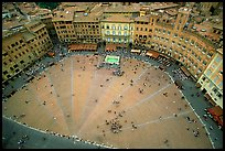 Medieval Piazza Del Campo with paving divided into nine sectors to represent Council of Nine.. Siena, Tuscany, Italy