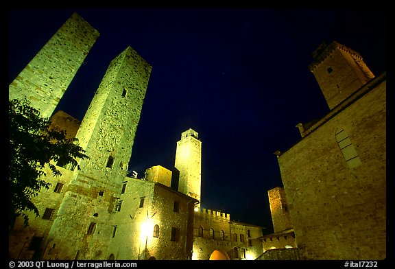 Medieval towers above Piazza del Duomo at night. San Gimignano, Tuscany, Italy (color)