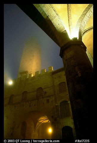 Medieval towers above Piazza del Duomo, foggy night. San Gimignano, Tuscany, Italy (color)