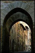 Arch and street. San Gimignano, Tuscany, Italy (color)