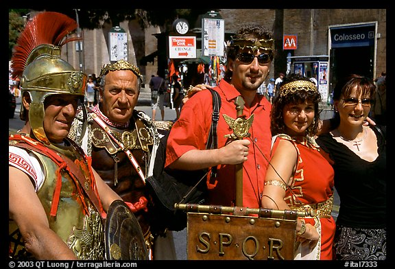 Roman Legionnaires pose with tourists, Roman Forum. Rome, Lazio, Italy (color)