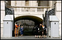 Nuns move past checkpoint manned by Swiss guards. Vatican City