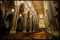 Church interior looking down the nave to the apse. Naples, Campania, Italy