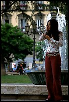 Young woman talking on a cell phone. Naples, Campania, Italy (color)