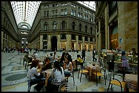 Women enjoy gelato inside the Galleria Umberto I. Naples, Campania, Italy