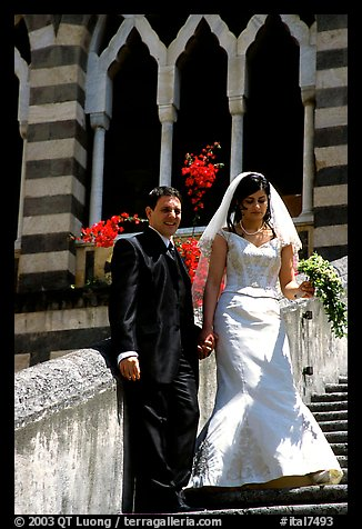 Newly wed couple on the stairs of Duomo Sant'Andrea, Amalfi. Amalfi Coast, Campania, Italy (color)