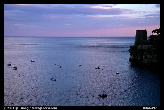 Small boats and tower and sunset, Positano. Amalfi Coast, Campania, Italy (color)