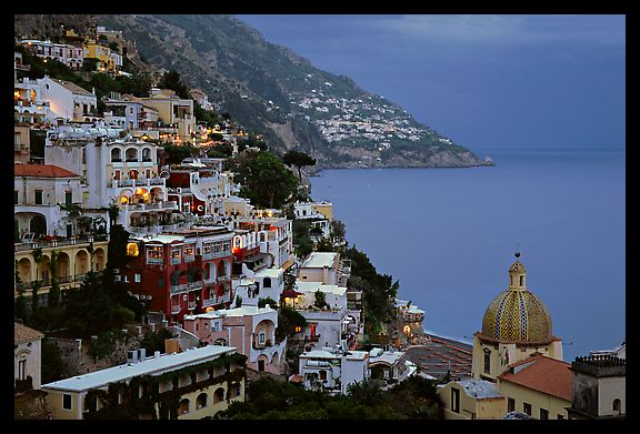Chiesa di Santa Maria Assunta and houses on steep hills at dusk, Positano. Amalfi Coast, Campania, Italy (color)