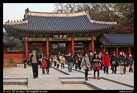 People walking down gate, Changdeok Palace. Seoul, South Korea (color)