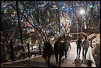 People on Namsan stairs by night. Seoul, South Korea ( color)