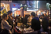 Busy food stall by night. Seoul, South Korea (color)