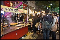 People lining up for street food. Seoul, South Korea ( color)