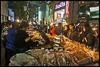 Unusual street foods on busy shopping street. Seoul, South Korea ( color)