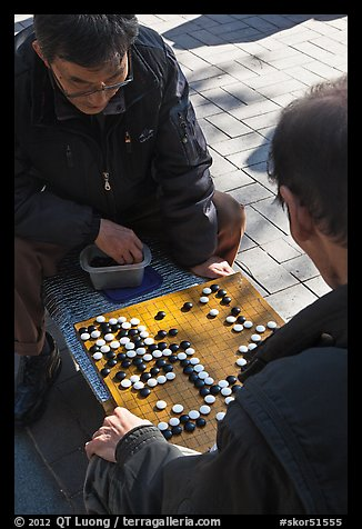 Pondering moves in go (baduk) game. Seoul, South Korea (color)