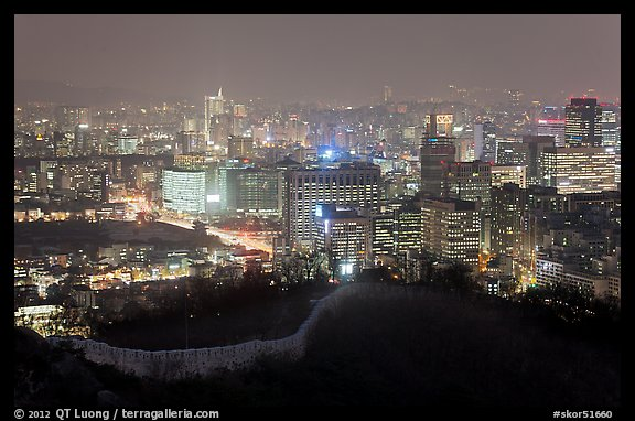 Old fortress wall and city skyline at night. Seoul, South Korea (color)
