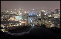 Old fortress wall and city skyline at night. Seoul, South Korea ( color)
