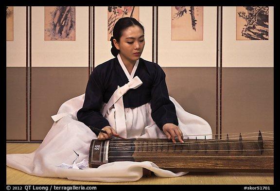 Woman playing traditional instrument. South Korea (color)