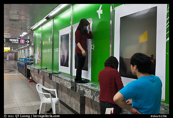 Photography exhibit being installed in subway. Daegu, South Korea (color)