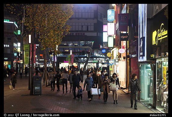 Shoppers strolling on pedestrian street at night. Daegu, South Korea (color)