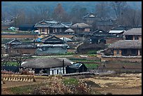 Straw roofed houses and tile roofed houses. Hahoe Folk Village, South Korea (color)