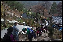 Hikers receiving sacred bread at Sangseonam hermitage, Mt Namsan. Gyeongju, South Korea (color)