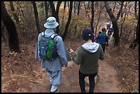 Monk and hikers on trail, Namsan Mountain. Gyeongju, South Korea (color)