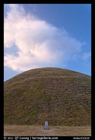 Mound of earth raised over grave and cloud. Gyeongju, South Korea (color)