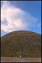 Mound of earth raised over grave and cloud. Gyeongju, South Korea ( color)