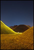 Grassy burial tumulus at night. Gyeongju, South Korea