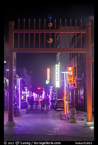 Gate and street with lights at night. Gyeongju, South Korea (color)