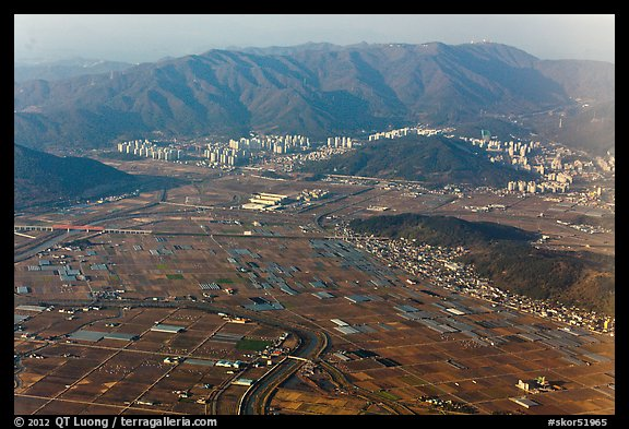 Aerial view of fileds and residential towers, Busan. South Korea (color)