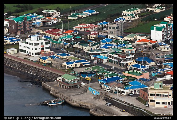 Houses with blue roofs, Seongsang Ilchulbong from above. Jeju Island, South Korea (color)